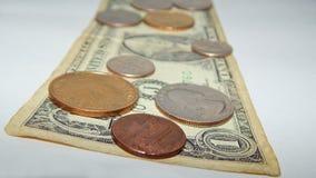 Dólar de papel com moedas dos E.U. Imagens de Stock Royalty Free