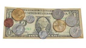 Dólar de papel con las monedas de los E.E.U.U. Imagenes de archivo