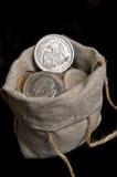 Dólar de plata de los E.E.U.U. en bolso Imágenes de archivo libres de regalías