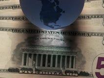 Dólar do globo Imagens de Stock