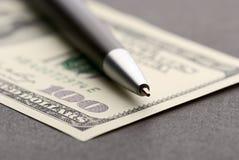 Dólar e pena Fotografia de Stock