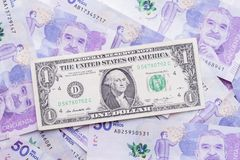 Dólar e peso colombiano Foto de Stock Royalty Free