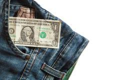 Dólar em seu bolso da calças de ganga Imagem de Stock Royalty Free