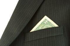 Dólar en el bolsillo de la capa Fotografía de archivo libre de regalías
