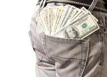 Dólar en el suyo tejanos del bolsillo de la parte posterior. Imagen de archivo libre de regalías