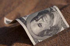 Dólar en la arena Foto de archivo