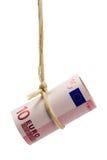 Dólar euro que cuelga Foto de archivo libre de regalías