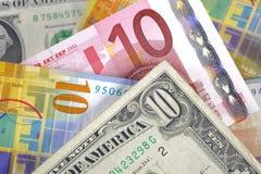 Dólar, euro y franco fotos de archivo