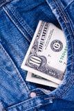 Dólar nas calças de brim Imagens de Stock