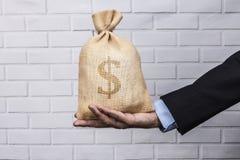 Dólar preto do saco disponível Fotografia de Stock Royalty Free