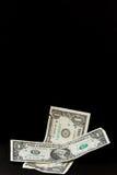Dólar que cae Imagenes de archivo