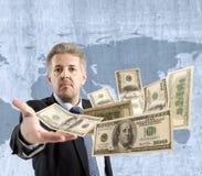 Dólar que lanza del hombre de negocios Foto de archivo libre de regalías