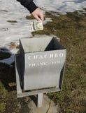 Dólares al cubo de la basura Imagen de archivo