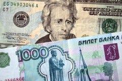 Dólares americanos e rublo russian fotografia de stock