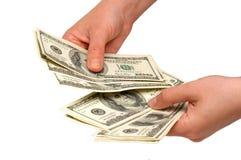 Dólares americanos en las manos Imagen de archivo