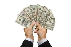 Dólares americanos en manos Imagen de archivo libre de regalías