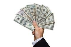 Dólares americanos en una mano Imágenes de archivo libres de regalías