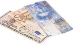 Dólares americanos, euro europeo, moneda del franco suizo Foto de archivo