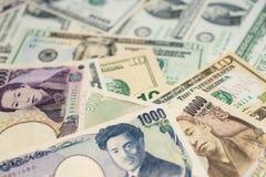 Dólares americanos, iene japonês Fotos de Stock