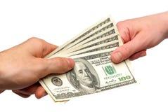 Dólares americanos nas mãos Fotografia de Stock Royalty Free