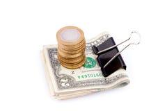 Dólares apertados por um grampo de papel Foto de Stock Royalty Free