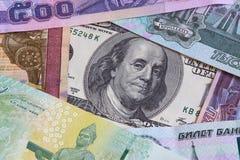 Dólares, baht y rublos fotos de archivo