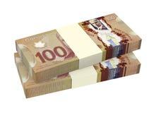 Dólares canadenses do dinheiro isolado no fundo branco Imagens de Stock