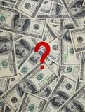 Dólares com um ponto de interrogação Fotografia de Stock