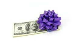 Dólares com uma curva Fotografia de Stock Royalty Free