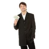 Dólares consideráveis novos da terra arrendada do homem de negócios Fotos de Stock Royalty Free