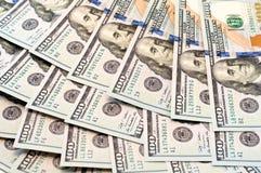Dólares da mentira em um fã Imagens de Stock