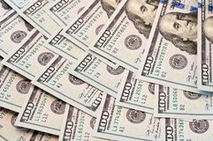 Dólares da mentira em um fã Foto de Stock Royalty Free