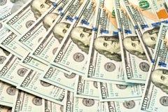 Dólares da mentira em um fã Fotos de Stock Royalty Free
