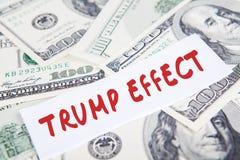Dólares da moeda e a palavra do efeito do trunfo Foto de Stock Royalty Free