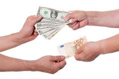 Dólares da troca de dinheiro para euro Fotografia de Stock Royalty Free