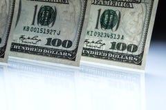 dólares de billetes de banco Dólares americanos de dinero del efectivo Cientos billetes de banco del dólar Imágenes de archivo libres de regalías