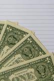 Dólares de billetes de banco en el cuaderno para el concepto financiero fotografía de archivo libre de regalías
