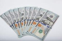 100 dólares de cédulas isoladas no fundo branco Foto de Stock Royalty Free