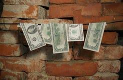 Dólares de caída en una cuerda Foto de archivo libre de regalías