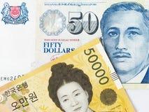 Dólares de Cingapura ganhado e 50 do coreano 50000 sul Foto de Stock Royalty Free
