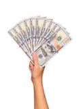 Dólares de cuentas en la mano femenina aislada Dinero Imágenes de archivo libres de regalías