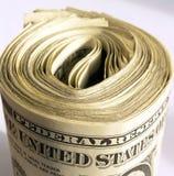 Dólares de EE. UU. rodados para arriba Foto de archivo libre de regalías