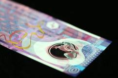 10 dólares de Hong Kong em um fundo escuro Imagem de Stock Royalty Free