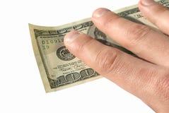 Dólares de la explotación agrícola de la mano Imagen de archivo libre de regalías