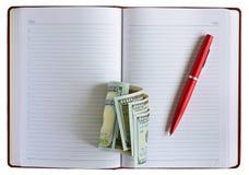 Dólares de la pluma del cuaderno Imagen de archivo libre de regalías