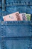 Dólares de Nova Zelândia no bolso das calças de brim Fotografia de Stock