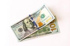 100 dólares de nuevos billetes de banco Imagen de archivo libre de regalías