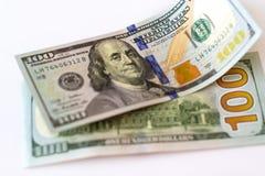 100 dólares de nuevos billetes de banco Foto de archivo