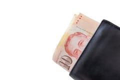 Dólares de Singapur en una cartera negra aislada en el fondo blanco fotos de archivo libres de regalías