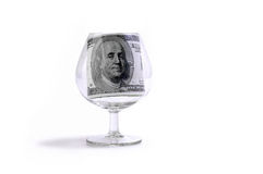 Dólares de un hundres en un vidrio Imagen de archivo